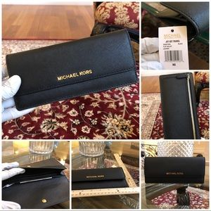 Authentic Michael Kors flap wallet with tags